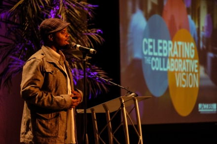 Gill Sotu performs an inspiring original spoke word piece at the Jacobs Center's Town Hall Series Launch on February 26.