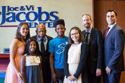 Several local students who participated in reading and discussion activities about MARCH had the opportunity to ask Congressman Lewis and his collaborators questions and pose for a photo.